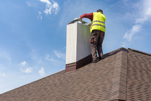 Man Install Chimney On Roof To...