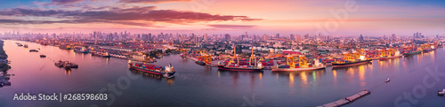 Fotografia  Aerial panoramic view of Logistics and transportation of Container Cargo ship an