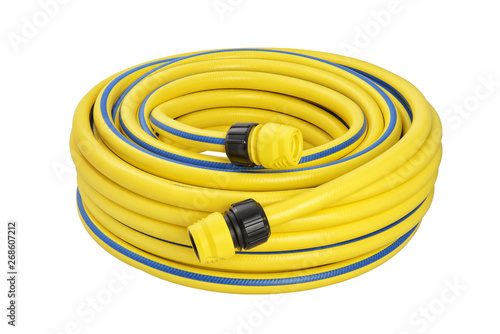 Vászonkép Coiled rubber garden hose isolated