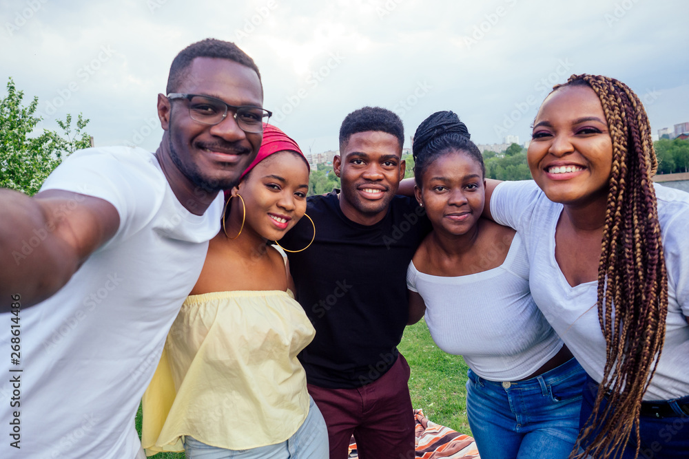Fototapety, obrazy: group of five friends female and male taking selfie on camera smartphone and having fun outdoors lifestyle near lake