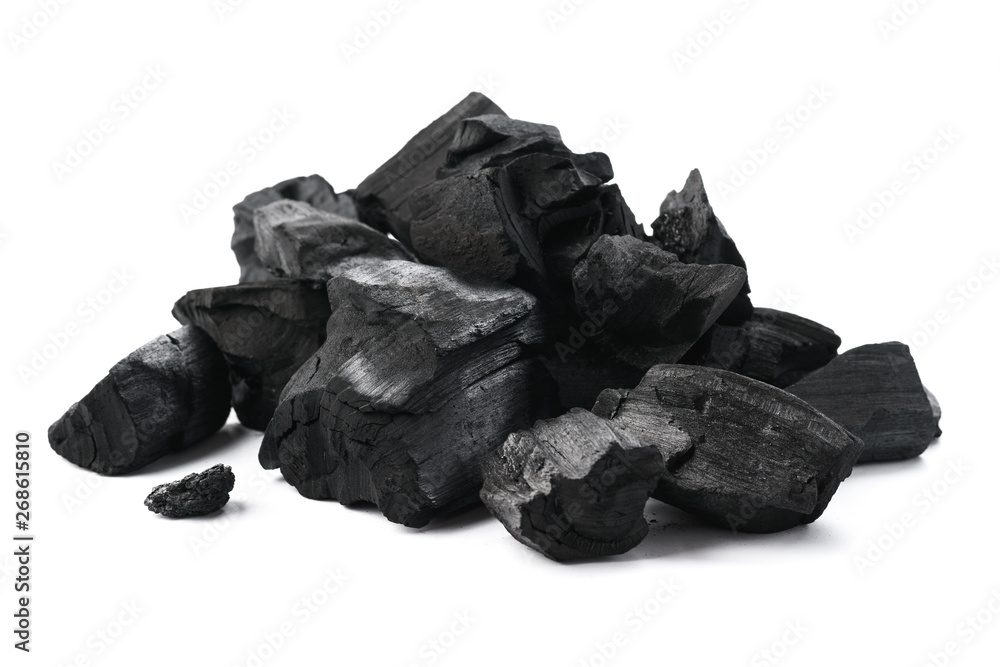 Fototapeta Pile of charcoal pieces isolated on white.