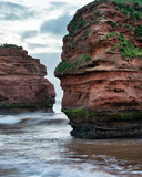 Stunning sunrise landscape image of Ladram Bay beach in Devon England with beautiful rock stacks on beach - 268616693