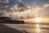 Stunning sunrise landscape image of Ladram Bay beach in Devon England with beautiful rock stacks on beach - 268617054