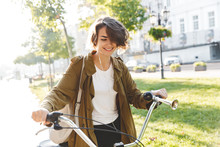 Cute Young Amazing Woman Walking Outdoors In Park With Bicycle Beautiful Spring Day.
