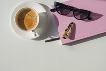 Cup, Notepad And Sunglasses On...