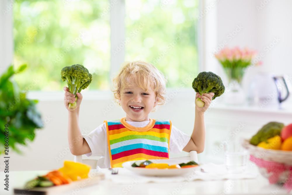 Fototapety, obrazy: Baby eating vegetables. Solid food for infant.