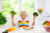 Baby eating vegetables. Solid food for infant. - 268624290