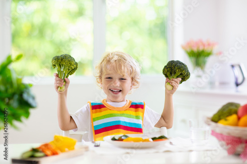 Fototapety, obrazy: Baby eating vegetables. Solid food for infant.