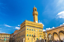 Palazzo Vecchio Palace With Bell Tower With Clock And Loggia Dei Lanzi On Piazza Della Signoria Square In Historical Centre Of Florence City, Blue Sky White Clouds, Tuscany, Italy