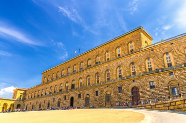 Facade of Palazzo Pitti palace with Gallery of Modern Art large building on Piazza dei Pitti square in historical centre of Florence city, blue sky white clouds, Tuscany, Italy