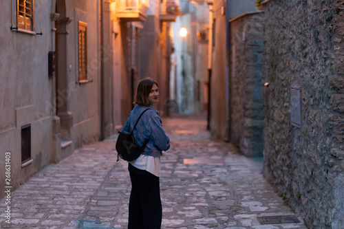handsome tourist girl visiting narrow streets of old town in southern Italy, Basilicata Apulia region