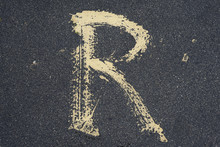 A Simple Letter R Painted On A...