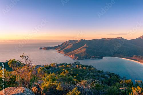 Fényképezés  Sunrise landscape of ocean coastline with mountains and beach