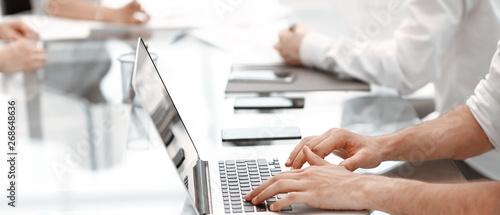 Fotomural  close up. businessman typing on laptop keyboard.