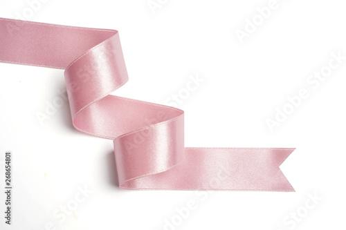 Fotografie, Obraz pink ribbon in roll on white