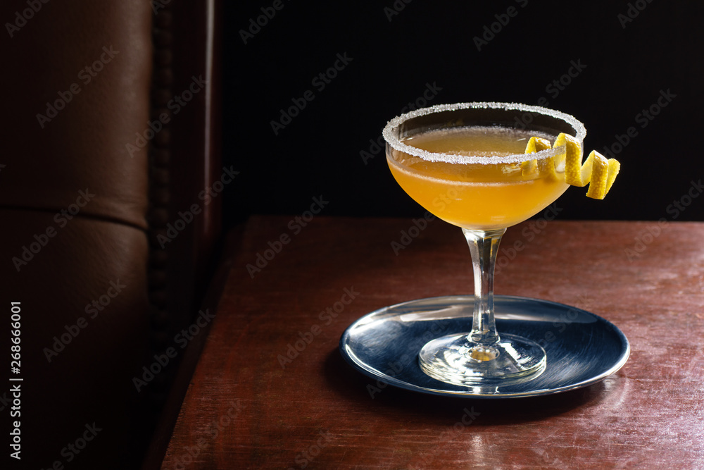 Fototapeta Sidecar Cocktail Served Up with Sugared Rim in Dark Luxurious Bar with Copy Space
