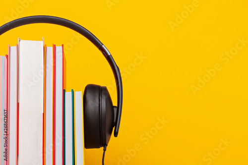 Group of books with the earphones. Audiobooks concept Canvas Print