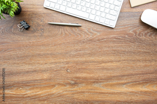 Wood office desk table with computer tools and supplies Canvas Print