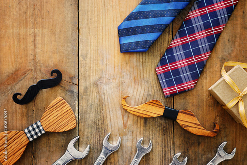 Canvas Prints Textures Father's day concept. gift box, tie and funny moustache over wooden background. top view, flat lay