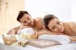 Leinwandbild Motiv Young couple with spa essentials in wellness center