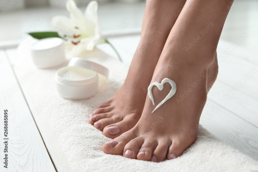 Fototapety, obrazy: Woman with beautiful feet and cream on white towel, closeup. Spa treatment