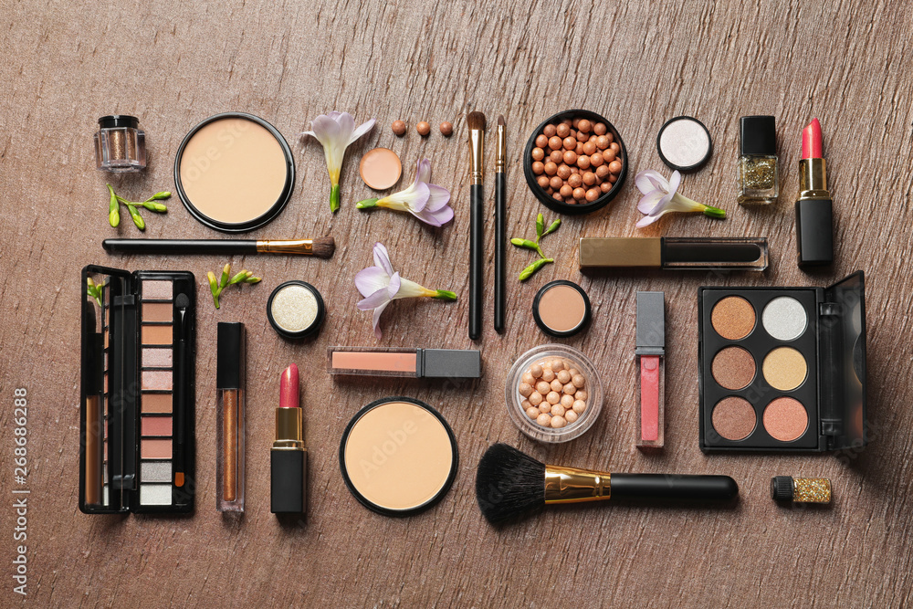 Fototapety, obrazy: Many different makeup products and spring flowers on color background, flat lay