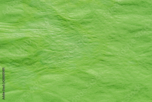 Fototapeta  green creased paper tissue background texture