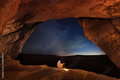 Foto auf Leinwand Violett rot Kachi-Kalon, Bakhchysarai, Republic of Crimea, Russia - April 1, 2019: Bedouin in the Crimean cave Kachi-Kalyon is heated by the fire on the background of the starry sky