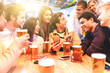 canvas print picture - Happy millennial friends at pub drinking beer