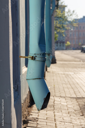 Valokuva  Old blue drainpipe on the wall. Fragment of the building