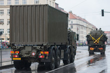 Soldiers Of Czech Army Are Riding Military Truck With Container