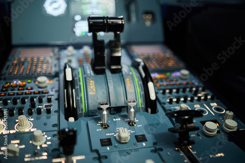 Cuadros en Lienzo Close-up of instrument panel of aircraft with buttons, switches and power levers