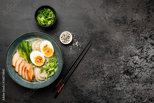 Ramen with chicken and egg on black concrete background Canvas Print
