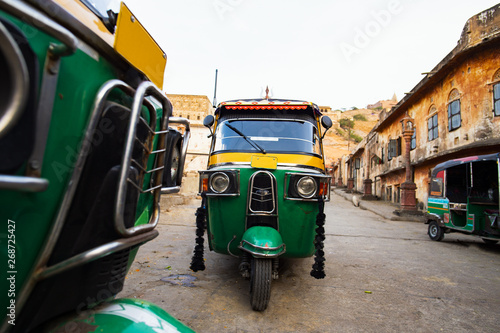 Fotografie, Obraz Beautiful view of some auto rickshaw (also known as Tuc Tuc) parked on the streets of Jaipur, Rajasthan, India