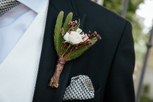 Boutonniere With A Rose On The Background Of The Groom's Jacket