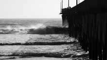 Crashing Waves And A Pier