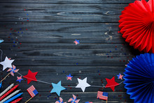 Decorations For 4th Of July Day Of American Independence, Flag, Candles, Straws. USA Holiday Decorations On A Wooden Background, Top View, Flat Lay