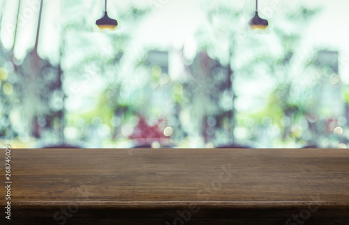 Empty wood table top with blurred cafe restaurant background. Mock up for display or montage of product,Business presentation