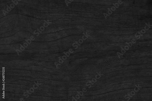 Fotografia  Wood texture background. Black surface of wooden blank for design