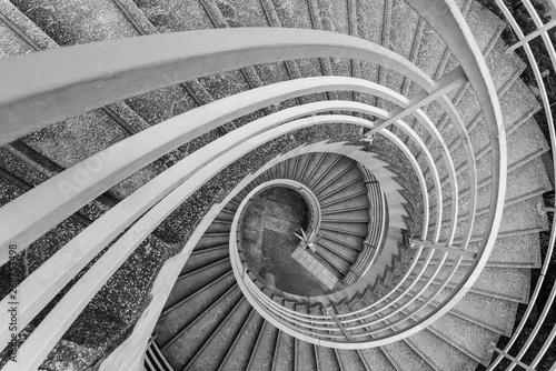 Fotografia  Empty modern spiral stairway, viewed from top