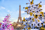 Fototapeta Fototapety z wieżą Eiffla - Eiffel Tower is the main attraction of Paris on the background of decorated Christmas trees in December. Travel Greeting Card with Christmas in Paris, France