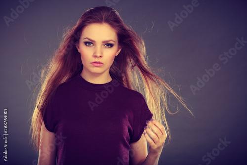 Attractive brunette woman with windblown hair Billede på lærred