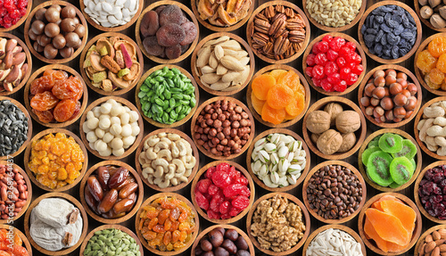 mixed nuts and dried fruits in bowls, top view. healthy snack for vegetarian, food background. - 268764437