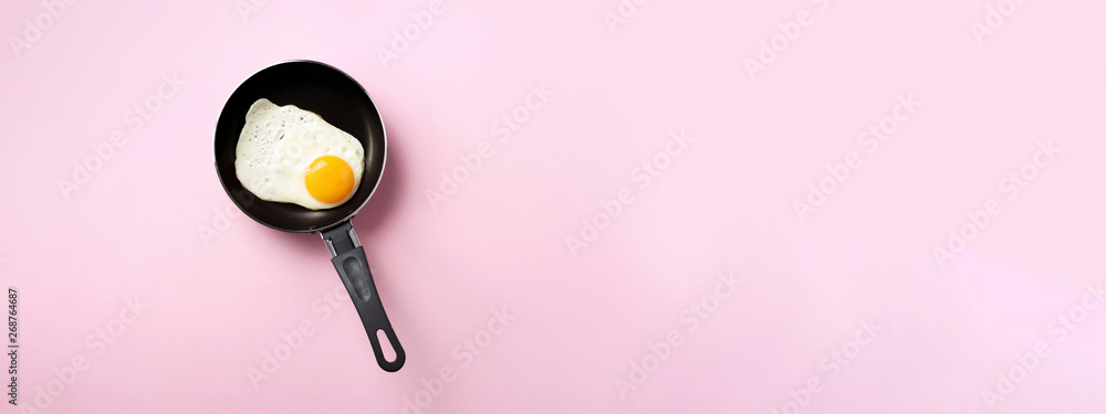 Fototapety, obrazy: Creative food concept with fried egg on pan over pink background. Top view. Creative pattern in minimal style. Flat lay. Banner