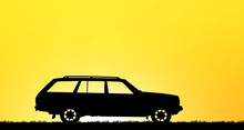 Silhouette Car On Sunset Background.