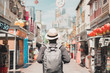 Leinwanddruck Bild - Young man hipster traveling with backpack and hat, happy Solo traveler walking at Chinatown street market in Singapore. landmark and popular for tourist attractions. Southeast Asia Travel concept