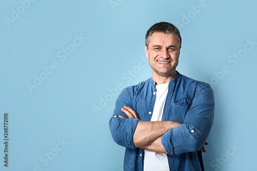 Fototapeta Portrait of handsome mature man on color background