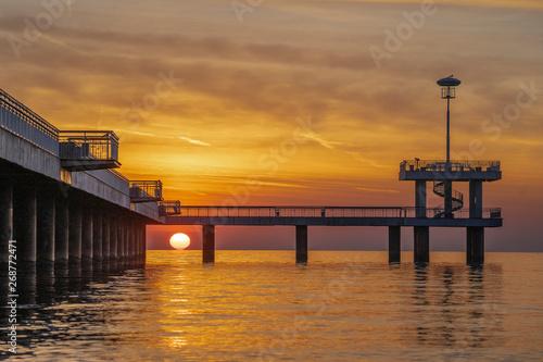 Red sunrise in Burgas on the bridge. Scenic sunrise.  #268772471