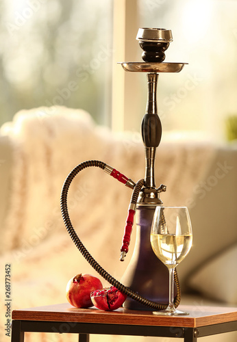 Hookah Pomegranate And Glass Of Alcohol On Table In Room Buy