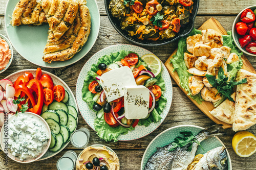 Recess Fitting Food Selection of traditional greek food - salad, meze, pie, fish, tzatziki, dolma on wood background, top view